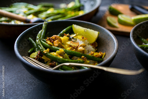 Green beans with coconut chips and mustard seeds, served in bowls, close-up Poster