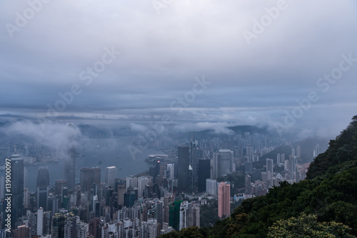 Misty morning view of Victoria harbor of Hong Kong city