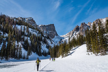 Crossing The Frozen Surface Of Dream Lake, Rocky Mountain National Park, Colorado