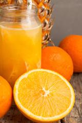 fruit juice, pineapple and oranges closeup.