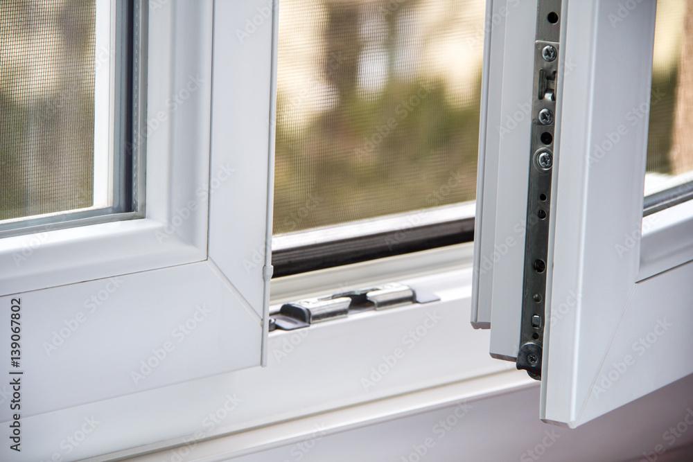 Fototapeta Secure anti-theft burglars-proof window locking mechanism – strong modern PVC metal window