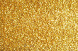 canvas print picture - Sprinkle glitter gold dust on a black background with copy space