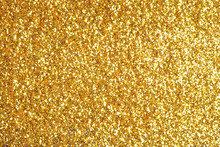 Sprinkle Glitter Gold Dust On A Black Background With Copy Space