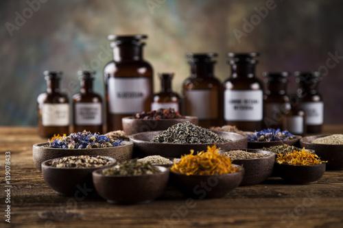 Fényképezés  Herbs medicine and vintage wooden desk background
