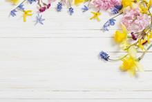 Flowers On White Wooden Backgr...