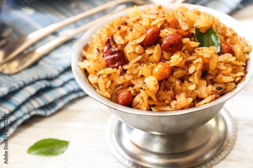 Tamarind Poha / Puli Aval - South Indian breakfast with flattened rice, selectiv Wallpaper Mural