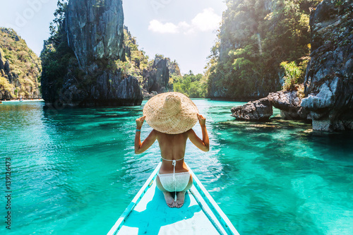 Woman travelling on the boat in Asia Wallpaper Mural