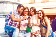 Happy multiracial group of friends looking tour city information on mobile phone - Multicultural students searching street map on smartphone app - Concept of tourism and new technologies
