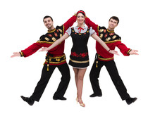 Two Men And One Woman Wearing A Folk Russian Costume Posing