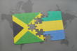 puzzle with the national flag of jamaica and gabon on a world map