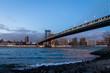 Manhattan Bridge and Manhattan Skyline at sunset - New York, USA