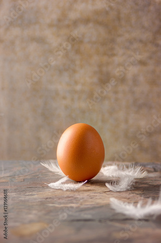 Fotografie, Obraz  eggs on a stone tile with feathers