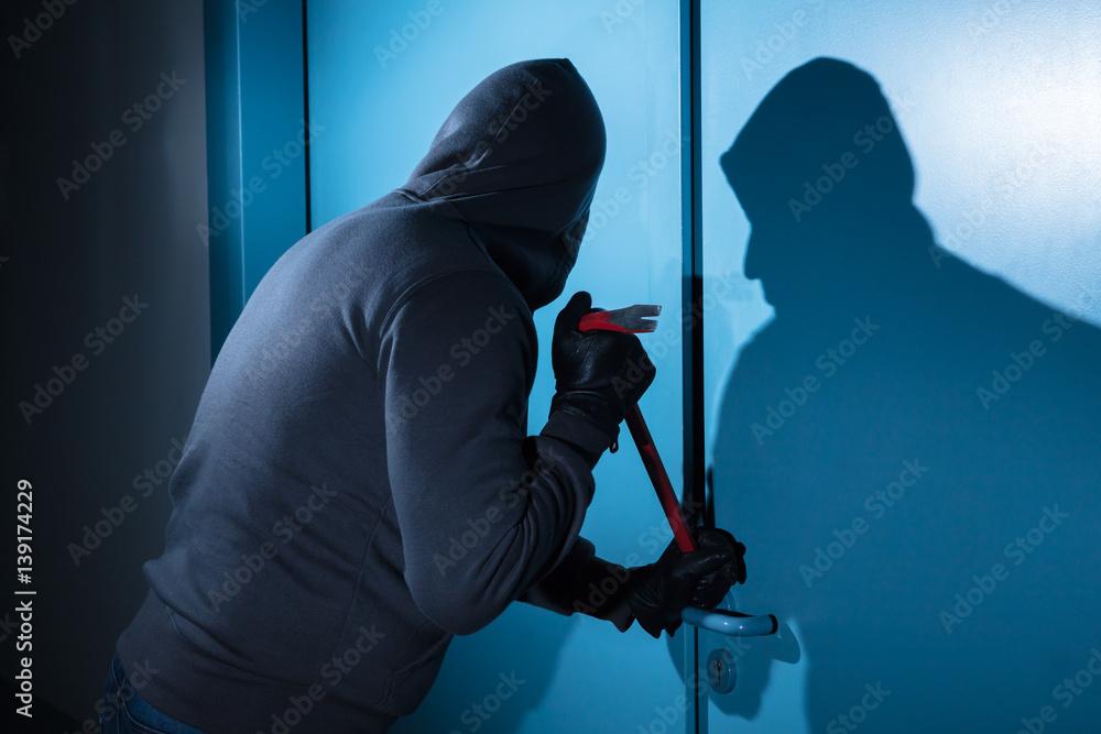 Fototapeta Thief Trying To Break The Door