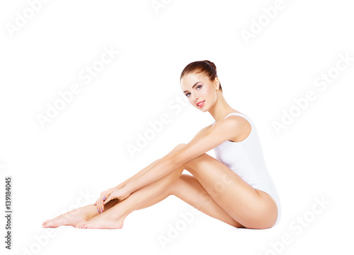 Fototapeta Fit and sporty girl in white underwear. Beautiful and healthy woman posing over isolated white background. Sport, fitness, diet, weight loss and healthcare concept. obraz na płótnie