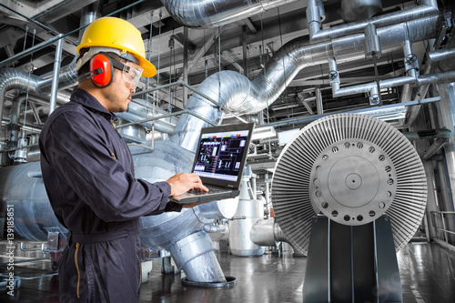 Fotografie, Obraz  Engineer using laptop computer in thermal power plant factory