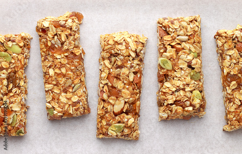 Homemade granola bars on white baking paper.
