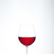 A glass of red wine. The concept of alcohol and party.