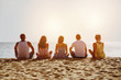 canvas print picture - Group of five friends on beach