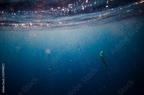 girl dive underwater, blurred soft focus abstract background with plankton Tapéta, Fotótapéta