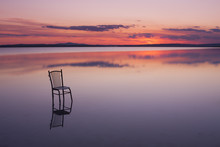 Chair On A Lake At Sunset
