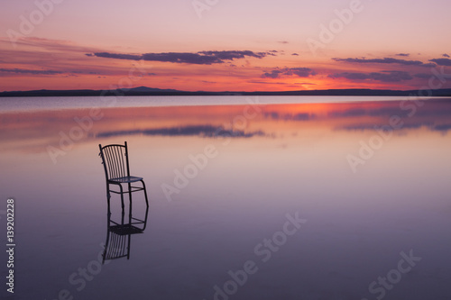 Fotografie, Obraz  chair on a lake at sunset