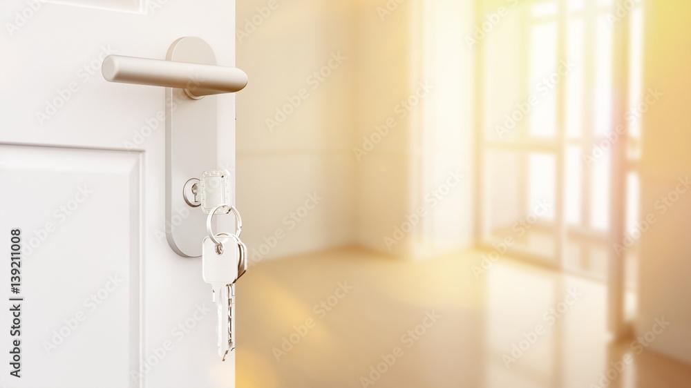 Valokuva Offene Tür mit Schlüssel in neuer Wohnung