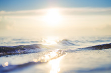 Sea Wave And Sky At Sunset. Blurred Background