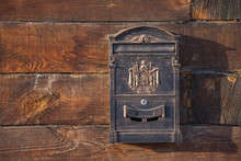 Old Brown Wooden Wall. Iron Mailbox