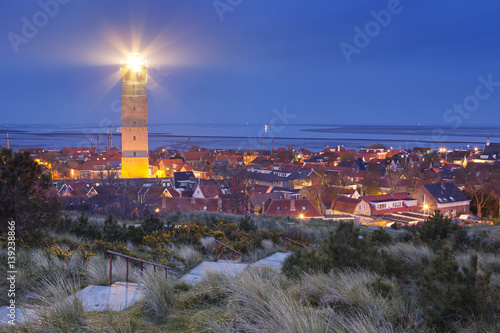 Montage in der Fensternische Leuchtturm Brandaris lighthouse on Terschelling, The Netherlands at night