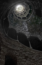 View Upwards From The Bottom Of The Initiation Well In Quinta Da Regaleira. Unfinished Well. Inverted Tower.