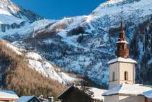 Argentiere Church In The Centre Of Argentiere Village In Winter.  The Argentiere Glacier In Behind The Village.