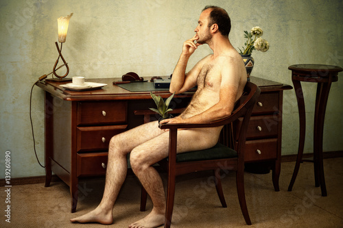 Poster Akt handsome naked man sitting thoughtful in the chair