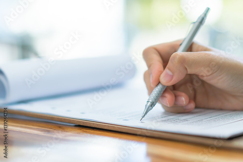 Hand with pen over application form . Canvas Print