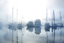 Boats In Ocean Harbor During E...
