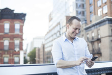 Man Text Messaging With Smartp...