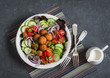 Falafel and fresh vegetables salad on dark background, top view. Vegetarian, diet food concept