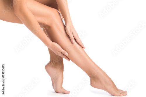 Fototapeta Female legs on white background