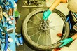 Top view of stylish bicycle mechanic working in mountain bike shop