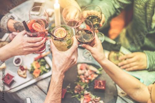 Fotografie, Obraz  Group of friends enjoying appetizer in american bar - Radial purple and green fi