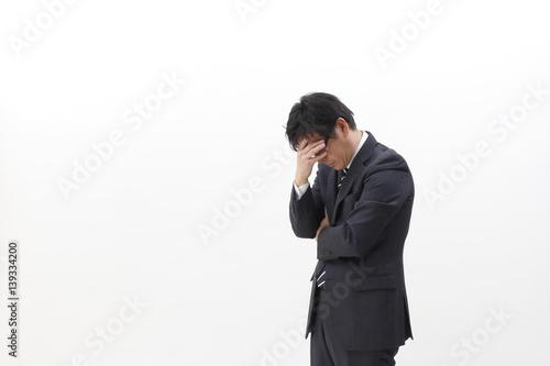 Fotografía  頭を抱えるビジネスマン