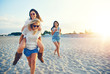 canvas print picture - three girlfriends laughing and smiling at the beach