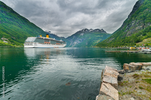Papiers peints Scandinavie Cruise ship in Geirangerfjord, the most popular fjord in Norway. View from the marina.