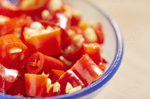 Fotografia, Obraz  A tablespoon of chopped hot, red pepper pieces