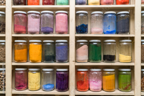 Maroc Glass bottles with colorful spices on the shelfs