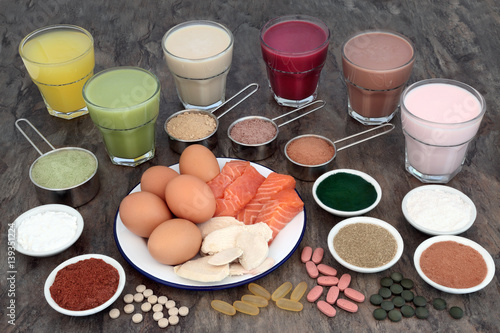 Fotografia  Health Food and Drinks for Body Builders  with high protein meat, fish, eggs and supplement powders with vitamin pills