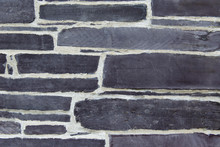 Blue Purple Pointed Slate Stone Wall Background. Textured Pattern Landscape Orientation