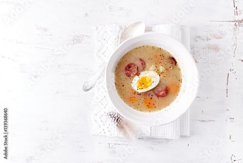 Deurstickers Klaar gerecht Polish Easter Soup made with Ray Flour, Egg and Sausage (Polish Zurek)