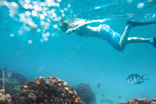 snorkeling on tropical beach, active tourism Wallpaper Mural