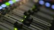Gain Sliders Of Sound Mixer Moving In Studio