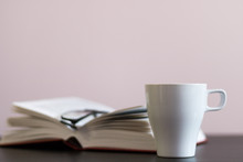 Reading With Cup Of